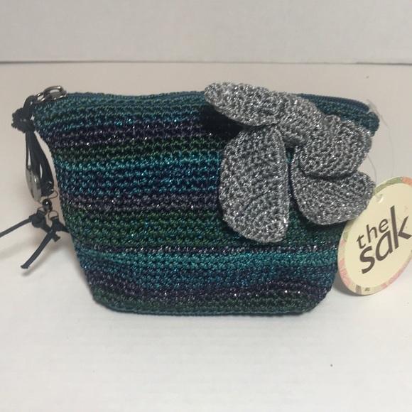 The Sak Handbags - The SAK makeup bag NWT removable broach bow clip